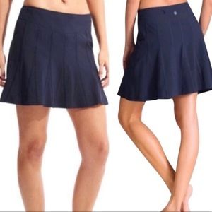 ATHLETA NAVY BLUE PLEATED HIGH WAISTED SKORT